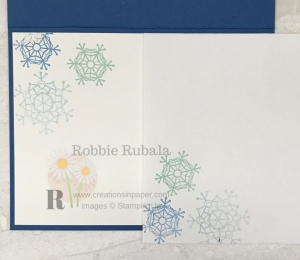 These are blue snowflakes in this photo but click through to see the watercolor background I created for my Watercolor Snowflakes Card.