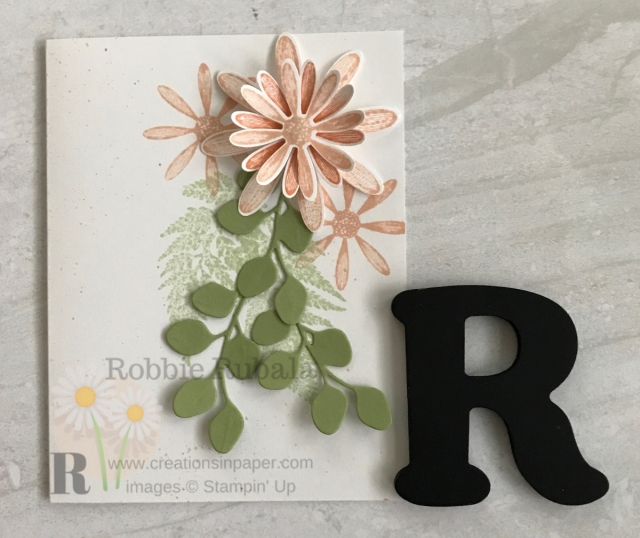 I love making flowers using daisy punches. Check out my version of A Fun Daisy Card. Click the photo.