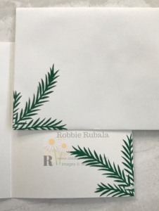 Nothing says Christmas like pine needles. I used the dies for this set to create my Stampin' Up Christmas Feels Like Frost card. Click the picture to see the card front.