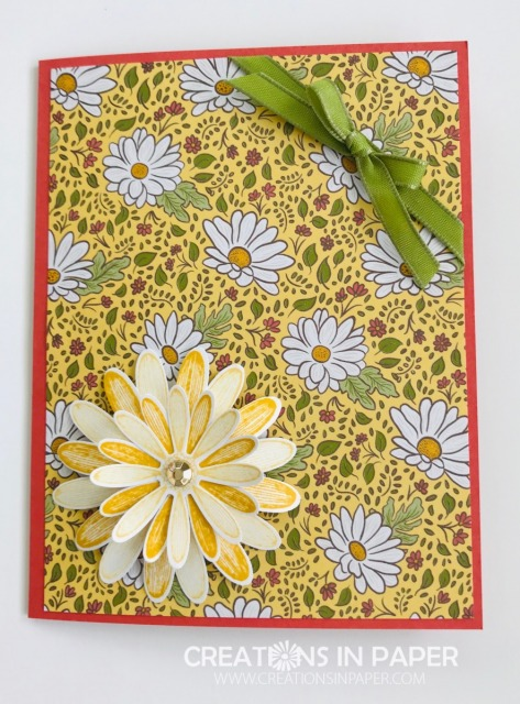 Designer Series Paper can be a great focal image for a card. The #ShopYourCraftStash With a Twist uses the beautiful daisy paper and a punched daisy for a simple card.