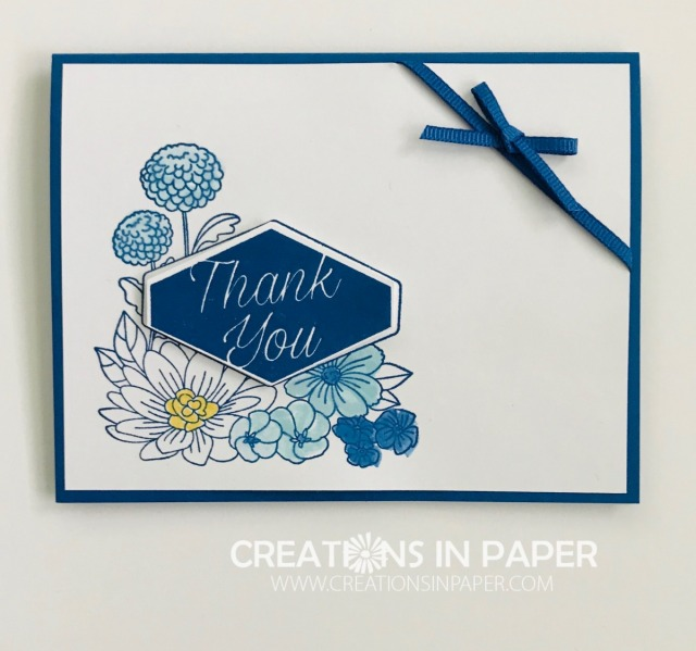 The soft blues combine with this bright blue to a clean and simple Goodbye Blueberry Bushel Accented Blooms idea. Watch the video to see how to color the image.