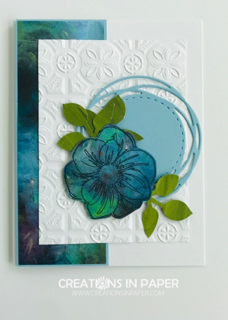 Stamping on designer series paper is a great way to get interesting images. The Floral Essence in blues and greens uses the watercolor pattern from the retired Perennial Essence designer series paper.